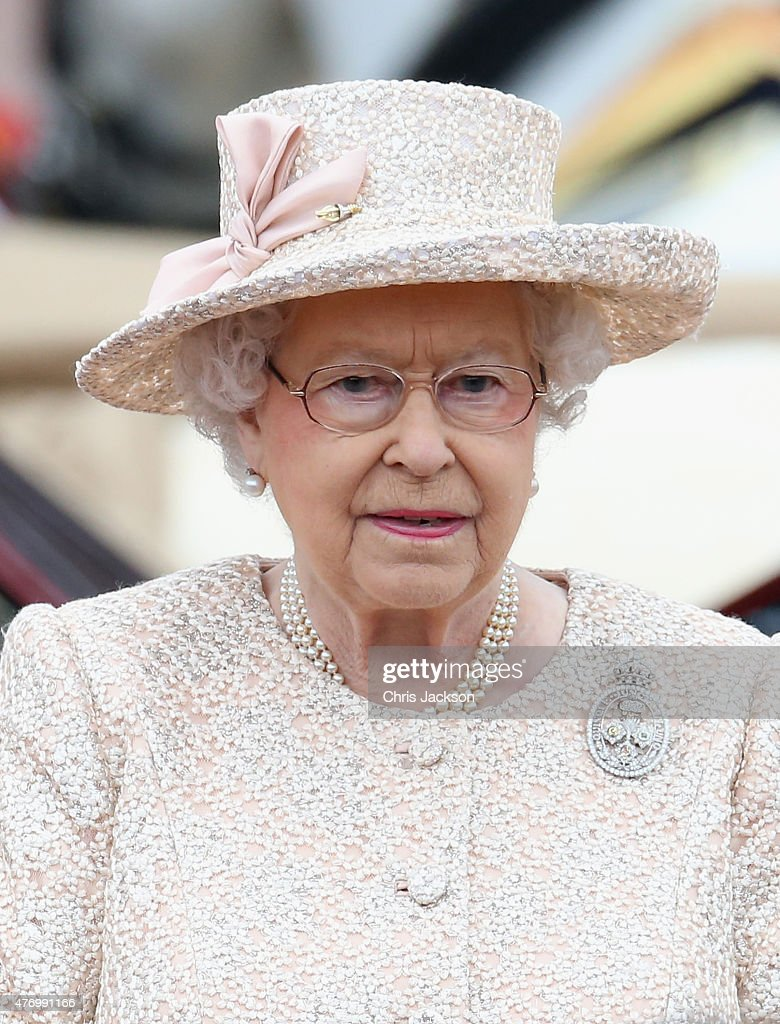 Queen Elizabeth II takes the salute during the Trooping the Colour Ceremony outside Buckingham Palace on June 13 2015 in London England The ceremony...