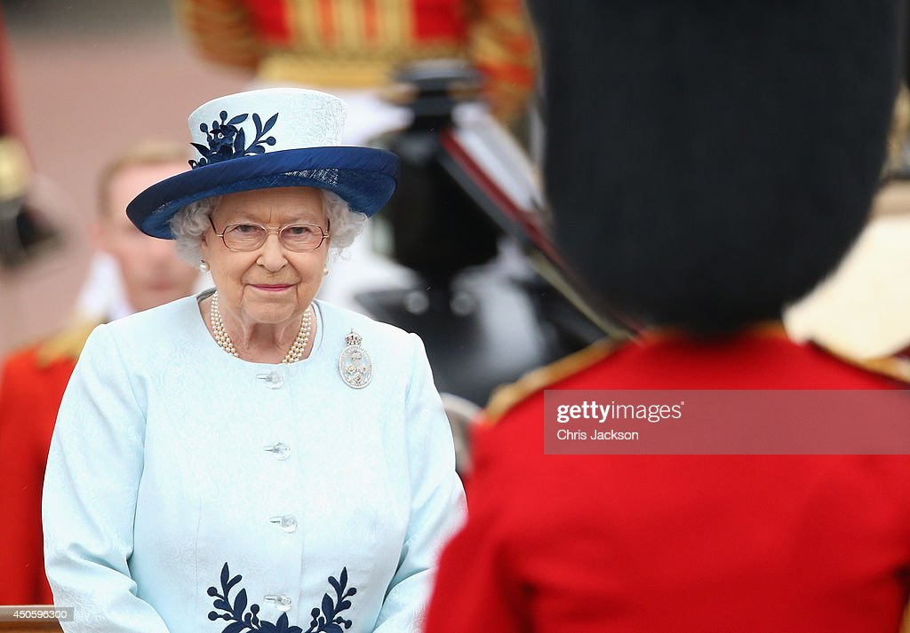 Queen Elizabeth II takes the salute during Trooping the Colour - Queen Elizabeth II's Birthday Parade, at The Royal Horseguards on June 14, 2014 in London, England.
