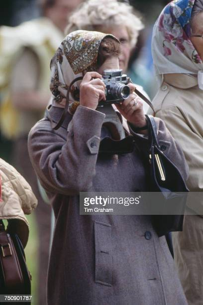 Queen Elizabeth II taking a photograph at the Royal Windsor Horse Show Windsor Great Park 15th May 1981