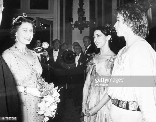 Queen Elizabeth II talking to Dame Margot Fonteyn and Rudolf Nureyev after they had danced the principal roles in the gala performance of Pelleas et...