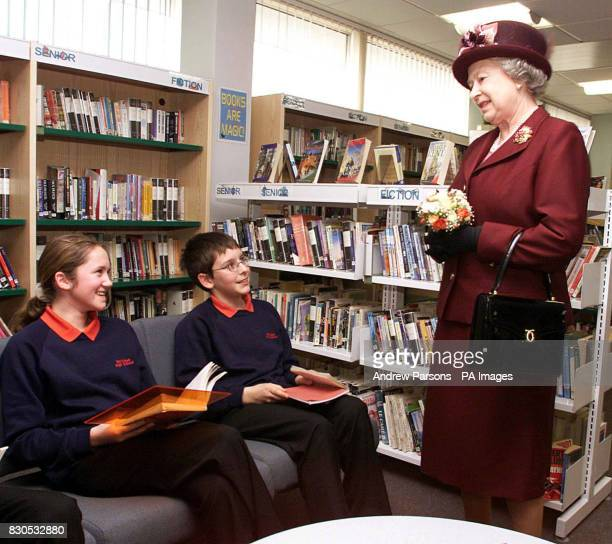 Queen Elizabeth II talking to students from the Carnegie Readers Medal Shaddowing Scheme during her visit to the Special Educational Needs Unit and...