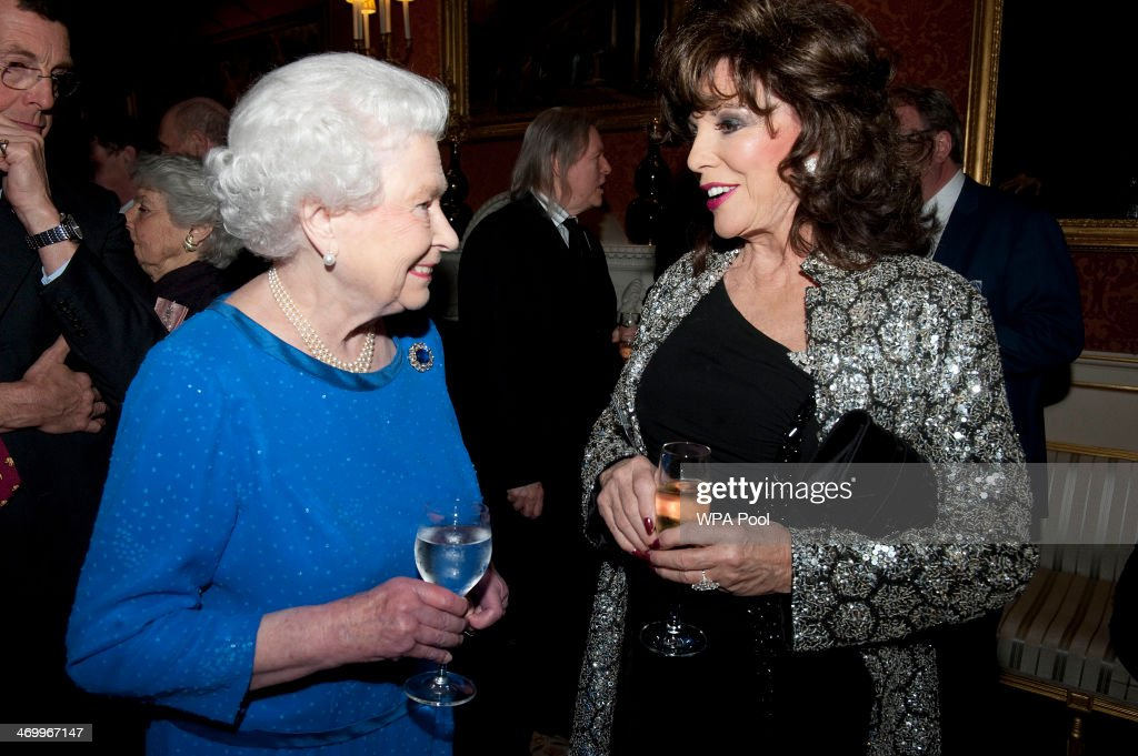 Queen Elizabeth II talks to actress Joan Collins during the Dramatic Arts reception at Buckingham Palace on February 17, 2014 in London, England.