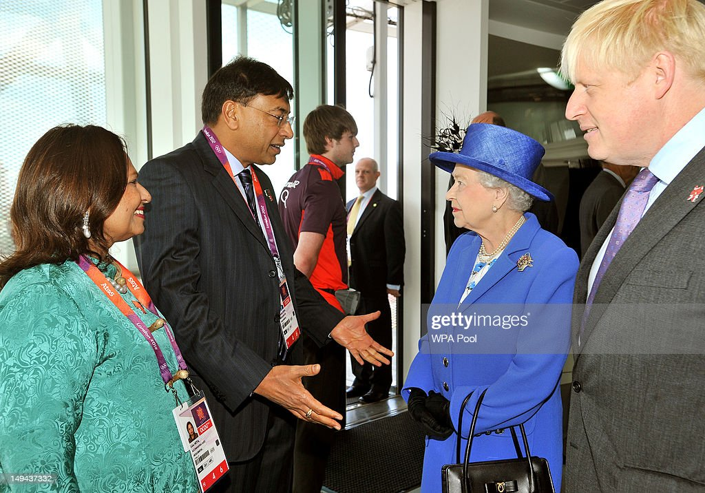 Queen Elizabeth II talks to Indian steel magnate Lakshmi Mittal who sponsored the Orbit and his wife, with Boris Johnson Mayor of London during a tour of the Olympic Park on day one of the London 2012 Olympics Games on July 28, 2012 in London, England.
