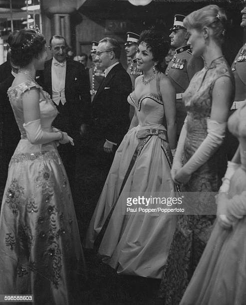 Queen Elizabeth II talks to Italian film star Gina Lollobrigida watched by actress Virginia McKenna and David Kossoff after the Royal Command...