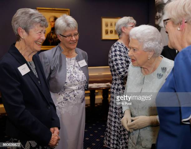 Queen Elizabeth II talks to Joan Berfield left a 96year old veteran of the Women's Royal Naval Service during a reception to celebrate the WRNS 100...