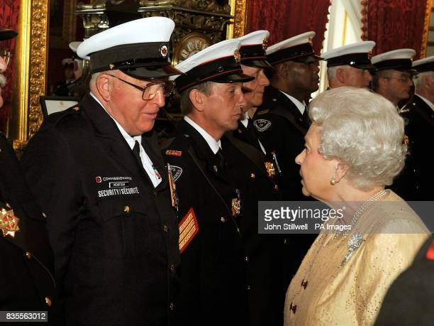 Queen Elizabeth II talks to John McIntosh from Canada during a reception for the Corps of Commissionaires in honour of their 150th anniversary at St...