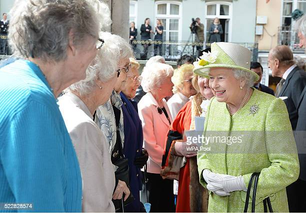 Queen Elizabeth II talks to local women who are all aged in their nineties during her 90th Birthday Walkabout on April 21 2016 in Windsor England...