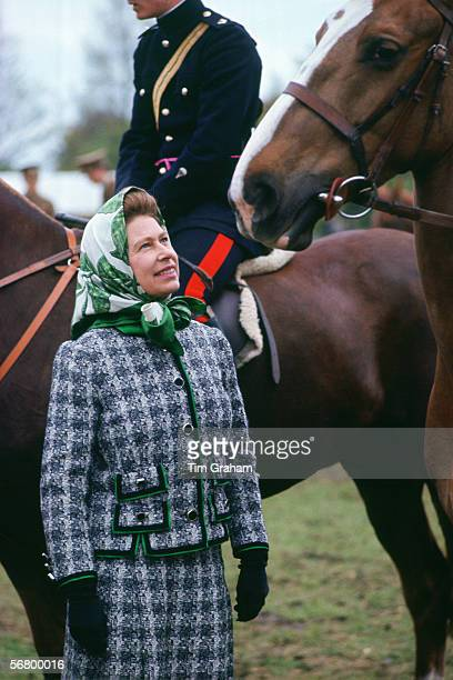 Queen Elizabeth II talks to riders at the Windsor Horse Show in the 1970s or early 1980s