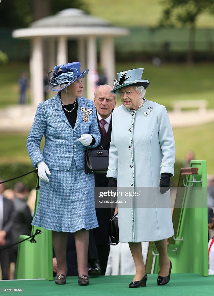 Queen Elizabeth II talks to Sarah Goad as the Magna Carta Commemoration Monument is seen in the background at a Magna Carta 800th Anniversary Commemoration Event on June 15, 2015 in Runnymede, United Kingdom. Members of the Royal Family are visiting Runnymede to attend an event commemorating the 800th anniversary of Magna Carta. Magna Carta is widely recognised as one of the most significant documents in history. Its influence, as a cornerstone of fundamental liberties, is felt around the world in the constitutions and political traditions of countless nations.