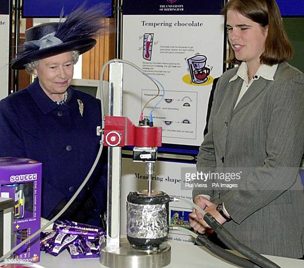 Queen Elizabeth II talks to student Kerstin Pinschower about chocolate tempering during a visit at the School of Chemical Engineering at the...