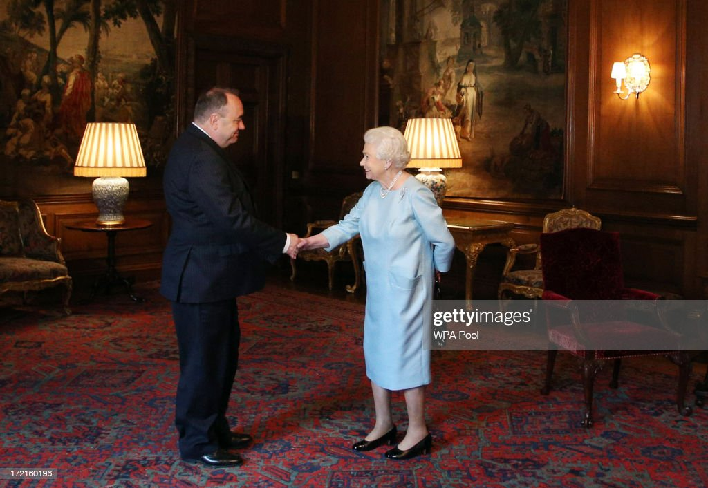 Queen <a gi-track='captionPersonalityLinkClicked' href=/galleries/search?phrase=Elizabeth+II&family=editorial&specificpeople=67226 ng-click='$event.stopPropagation()'>Elizabeth II</a> talks to the Scottish First minister <a gi-track='captionPersonalityLinkClicked' href=/galleries/search?phrase=Alex+Salmond&family=editorial&specificpeople=857688 ng-click='$event.stopPropagation()'>Alex Salmond</a> during an audience at the Palace of Holyrood House on July 2, 2013 in Edinburgh, Scotland. The Queen has several engagements on her annual week in Scotland.
