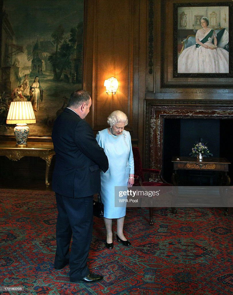 Queen Elizabeth II talks to the Scottish First minister <a gi-track='captionPersonalityLinkClicked' href=/galleries/search?phrase=Alex+Salmond&family=editorial&specificpeople=857688 ng-click='$event.stopPropagation()'>Alex Salmond</a> during an audience at the Palace of Holyrood House on July 2, 2013 in Edinburgh, Scotland. The Queen has several engagements on her annual week in Scotland.