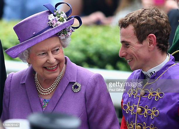 Queen Elizabeth II talks with Jockey Ryan Moore after the Queen's horse Estimate won The Gold Cup on Ladies' Day during day three of Royal Ascot at...