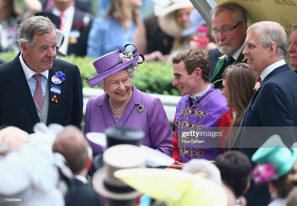Queen <a gi-track='captionPersonalityLinkClicked' href=/galleries/search?phrase=Elizabeth+II&family=editorial&specificpeople=67226 ng-click='$event.stopPropagation()'>Elizabeth II</a> talks with Jockey Ryan Moore after the Queen's horse Estimate won The Gold Cup on Ladies' Day during day three of Royal Ascot at Ascot Racecourse on June 20, 2013 in Ascot, England.