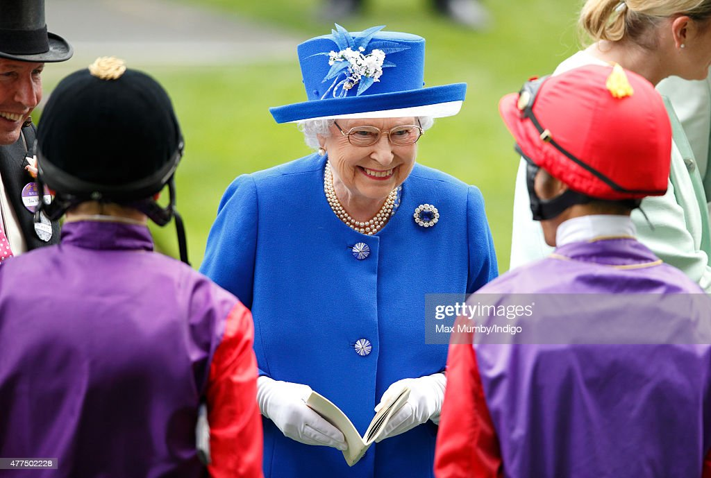 Queen Elizabeth II talks with jockeys Jamie Spencer and Sean Levey prior to them riding her horses 'Touchline' and 'Pack Together' in The Sandringham Handicap Stakes on day 2 of Royal Ascot at Ascot Racecourse on June 17, 2015 in Ascot, England.
