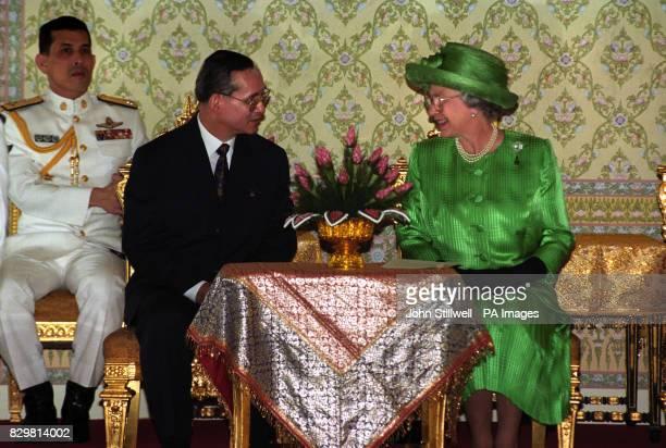 Queen Elizabeth II talks with King Bhumibol of Thailand following her arrival in Bangkok