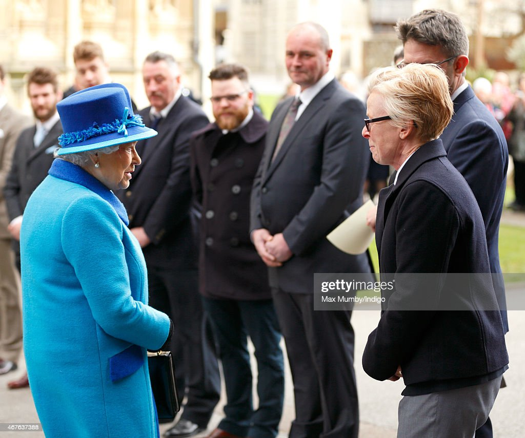 Queen Elizabeth II talks with Nina Bilbey (sculptor of the statues of The Queen and Prince Philip, Duke of Edinburgh) as she visits Canterbury Cathedral to unveil a statue of herself and one of Prince Philip, Duke of Edinburgh to mark her Diamond Jubilee on March 26, 2015 in Canterbury, England.