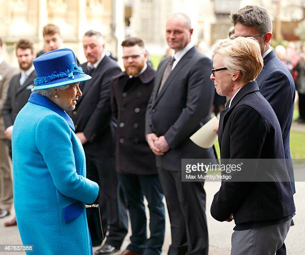 Queen Elizabeth II talks with Nina Bilbey as she visits Canterbury Cathedral to unveil a statue of herself and one of Prince Philip Duke of Edinburgh...