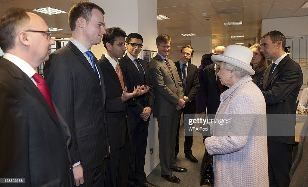 Queen <a gi-track='captionPersonalityLinkClicked' href=/galleries/search?phrase=Elizabeth+II&family=editorial&specificpeople=67226 ng-click='$event.stopPropagation()'>Elizabeth II</a> talks with staff as she visits the Bank of England with Prince Philip, Duke of Edinburgh on December 13, 2012 in London, England. Governor, Sir Mervyn King met with the Queen and Duke before they visited the Banking Hall to discuss payment system controls. The royal couple viewed banknotes, counterfeit currency, a gold vault, historical items, met with gold experts, security staff and the Market Operations Office while on their visit to the Bank of England.