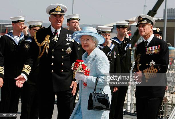 Queen Elizabeth II The Duke of Edinburgh and Admiral Sir Alan West make their way to review the fleet on June 28 2005 in Portsmouth England...