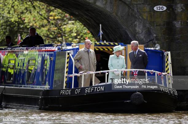 Queen Elizabeth II The Duke of Edinburgh and The Prince of Wales make their way along the Leeds and Liverpool canal on a barge called the Pride Of...