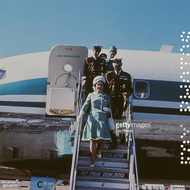 Queen Elizabeth II the Duke of Edinburgh Prince Charles and Princess Anne disembark from an Air New Zealand aircraft during their visit to New...