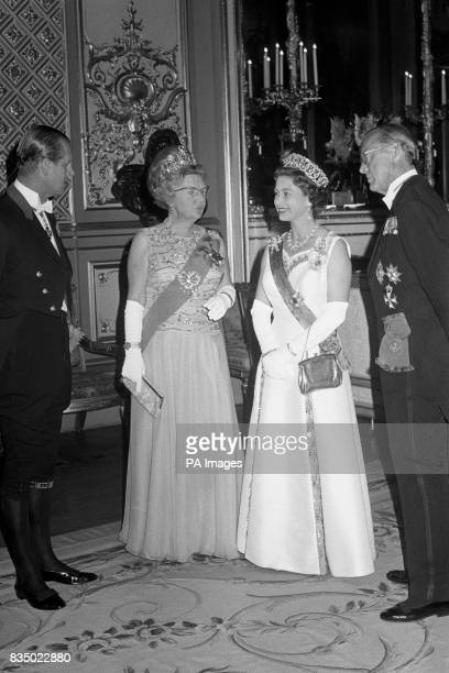 Queen Elizabeth II the Duke of Edinburgh Queen Juliana of the Netherlands and Prince Bernhard about to receive the guests at the State Banquet in St...
