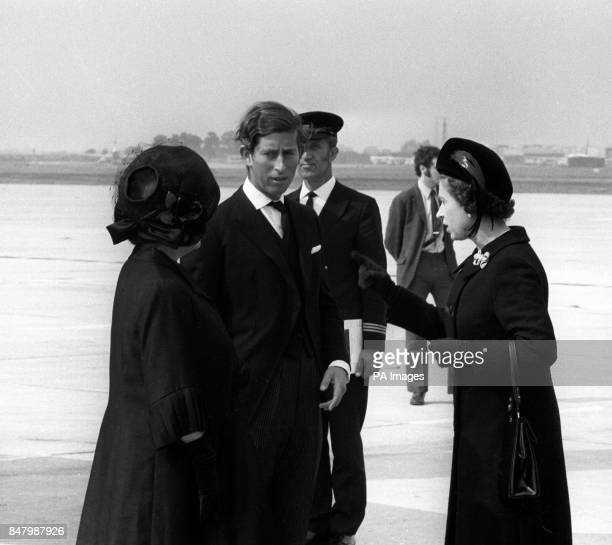 Queen Elizabeth II the Prince of Wales and the Queen Mother in mourning black at Heathrow Airport on their arrival from Aberdeen Airport having...