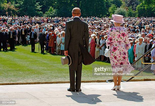 HM Queen Elizabeth II The Queen and Prince Philip Duke of Edinburgh look on at the first royal garden party of the summer in the grounds of...