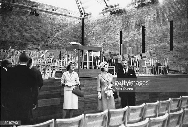 Queen Elizabeth II tours the newly opened Snape Maltings Concert Hall at the start of the twentieth Aldeburgh Festival with composer and festival...