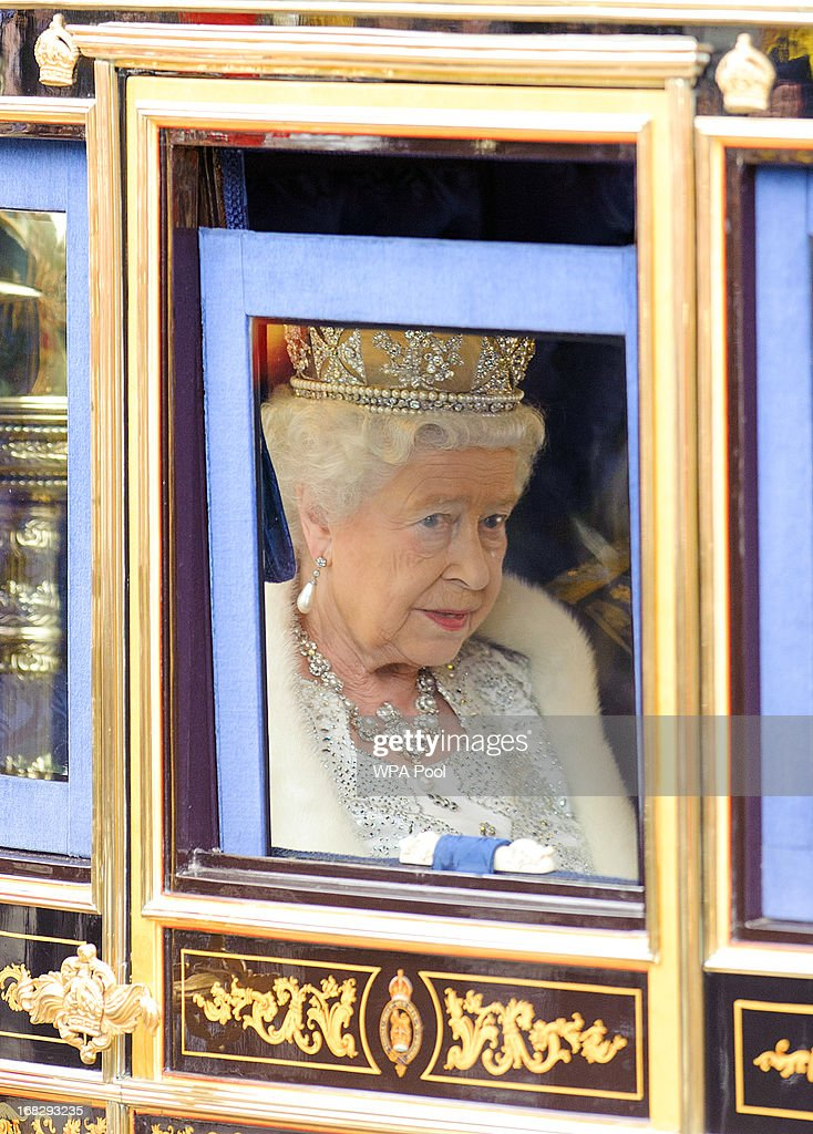 Queen <a gi-track='captionPersonalityLinkClicked' href=/galleries/search?phrase=Elizabeth+II&family=editorial&specificpeople=67226 ng-click='$event.stopPropagation()'>Elizabeth II</a> travels by coach to the State Opening of Parliament on May 8, 2013 in London, England. Queen <a gi-track='captionPersonalityLinkClicked' href=/galleries/search?phrase=Elizabeth+II&family=editorial&specificpeople=67226 ng-click='$event.stopPropagation()'>Elizabeth II</a> will unveil the coalition government's legislative programme in a speech delivered to Members of Parliament and Peers in The House of Lords. Proposed legislation is expected to be introduced on toughening immigration regulations, capping social care costs in England and setting a single state pension rate of 144 GBP per week.
