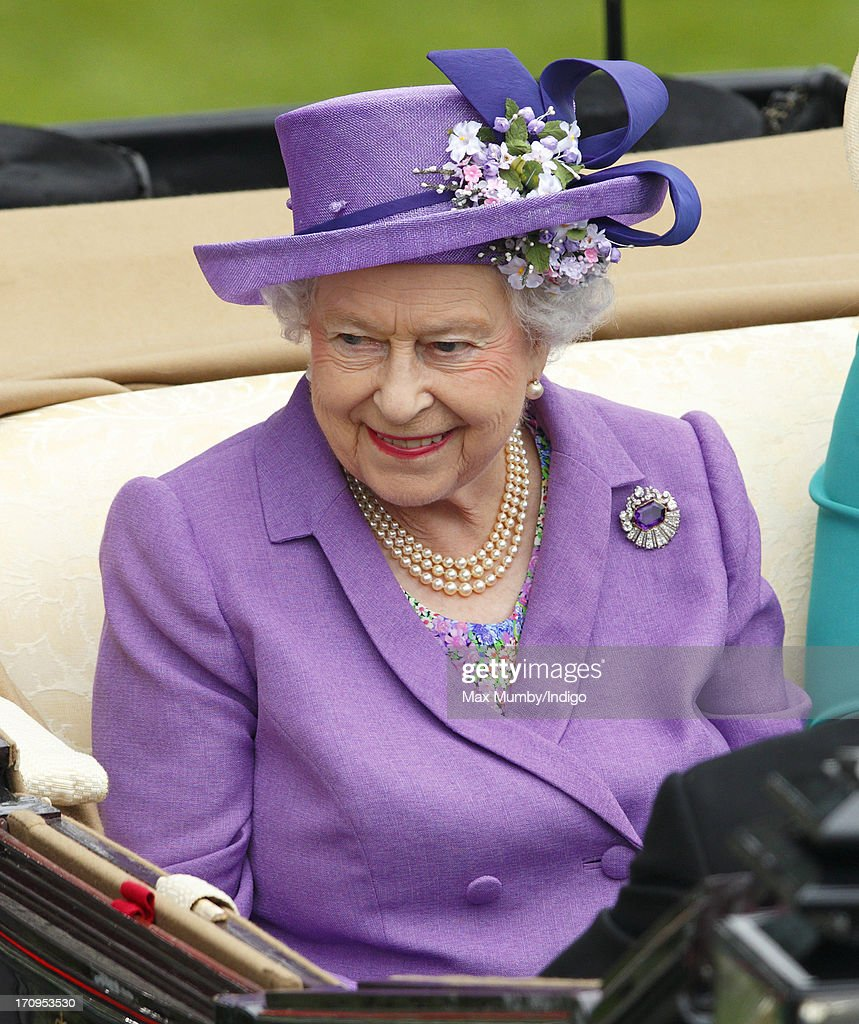 Queen <a gi-track='captionPersonalityLinkClicked' href=/galleries/search?phrase=Elizabeth+II&family=editorial&specificpeople=67226 ng-click='$event.stopPropagation()'>Elizabeth II</a> travels in a horse drawn carriage to attend Ladies Day of Royal Ascot at Ascot Racecourse on June 20, 2013 in Ascot, England.