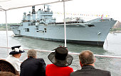 Queen Elizabeth II turns to talk to Canadian Prime Minister Stephen Harper as they pass HMS Ark Royal on June 29 2010 in Halifax Canada The Queen and...