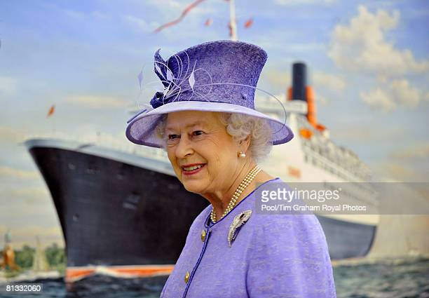 Queen Elizabeth II unveils a painting of the QE2 during a visit to the QE2 ocean liner in Southampton dock on June 2 2008 in Southampton England