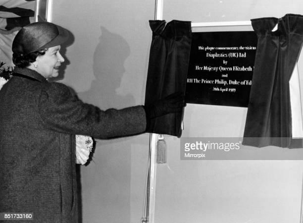 Queen Elizabeth II unveils a plaque to commemorate her visit to the Displastics factory at Waterton Cross Bridgend 20th April 1989