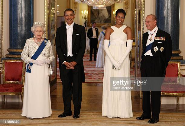 Queen Elizabeth II US President Barack Obama his wife Michelle Obama and Prince Philip Duke of Edinburgh pose in the Music Room of Buckingham Palace...