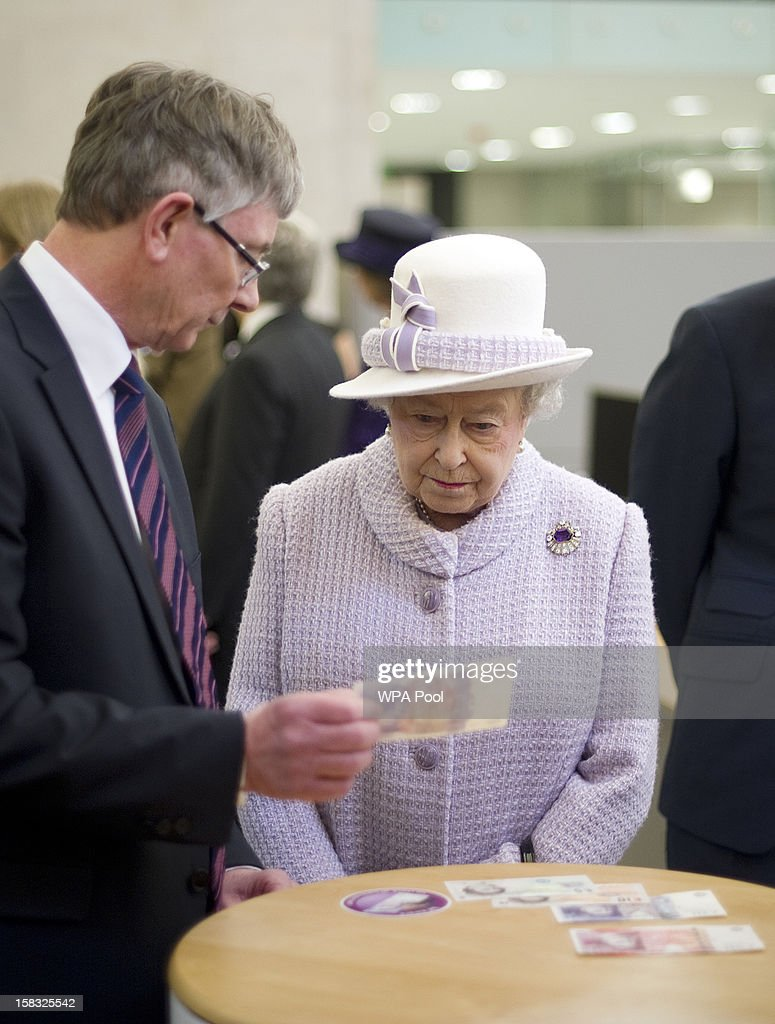 Queen Elizabeth II views bank notes as she visits the Bank of England with Prince Philip, Duke of Edinburgh on December 13, 2012 in London, England. Governor, Sir Mervyn King met with the Queen and Duke before they visited the Banking Hall to discuss payment system controls. The royal couple viewed banknotes, counterfeit currency, a gold vault, historical items, met with gold experts, security staff and the Market Operations Office while on their visit to the Bank of England.