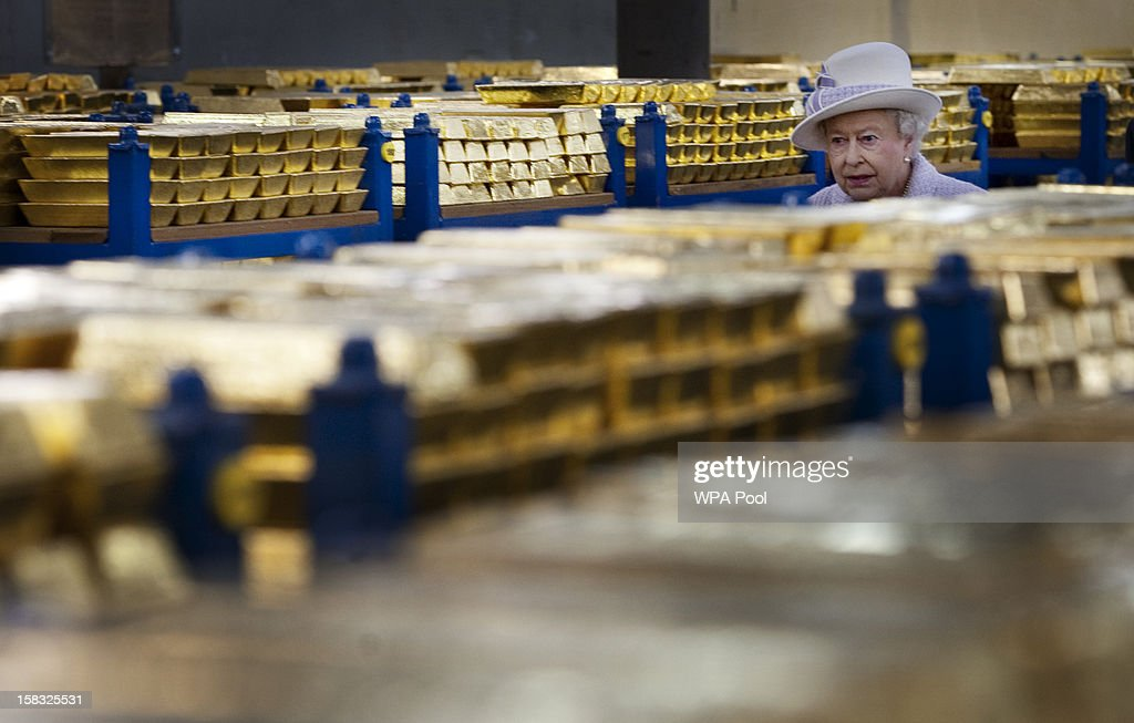Queen <a gi-track='captionPersonalityLinkClicked' href=/galleries/search?phrase=Elizabeth+II&family=editorial&specificpeople=67226 ng-click='$event.stopPropagation()'>Elizabeth II</a> views stacks of gold as she visits the Bank of England with Prince Philip, Duke of Edinburgh on December 13, 2012 in London, England. Governor, Sir Mervyn King met with the Queen and Duke before they visited the Banking Hall to discuss payment system controls. The royal couple viewed banknotes, counterfeit currency, a gold vault, historical items, met with gold experts, security staff and the Market Operations Office while on their visit to the Bank of England.