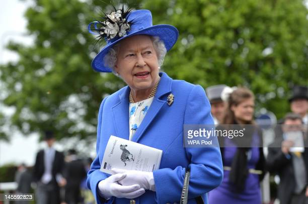 Queen Elizabeth II views the horses in the parade ring before the Diamond Jubilee Coronation Cup race on Derby Day on June 2 2012 in Epsom England...