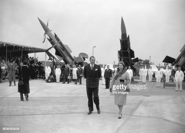 Queen Elizabeth II visiting the factory of English Electric Aviation Ltd during her tour of Stevenage New Town In the background is a Thunderbird...