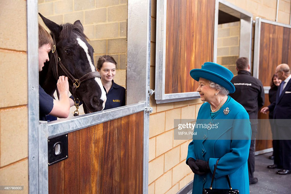 Queen Elizabeth II visits the Large Animals Clinical Skills Building where they saw horses and livestock during their visit to open the new School of Veterinary Medicine at the University of Surrey on October 15, 2015 in Guildford, Surrey, England.