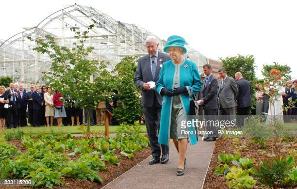 Queen Elizabeth II visits the Royal Horticultural Society Garden at Wisley Surrey accompanied by the society's President Peter Buckley where as RHS...
