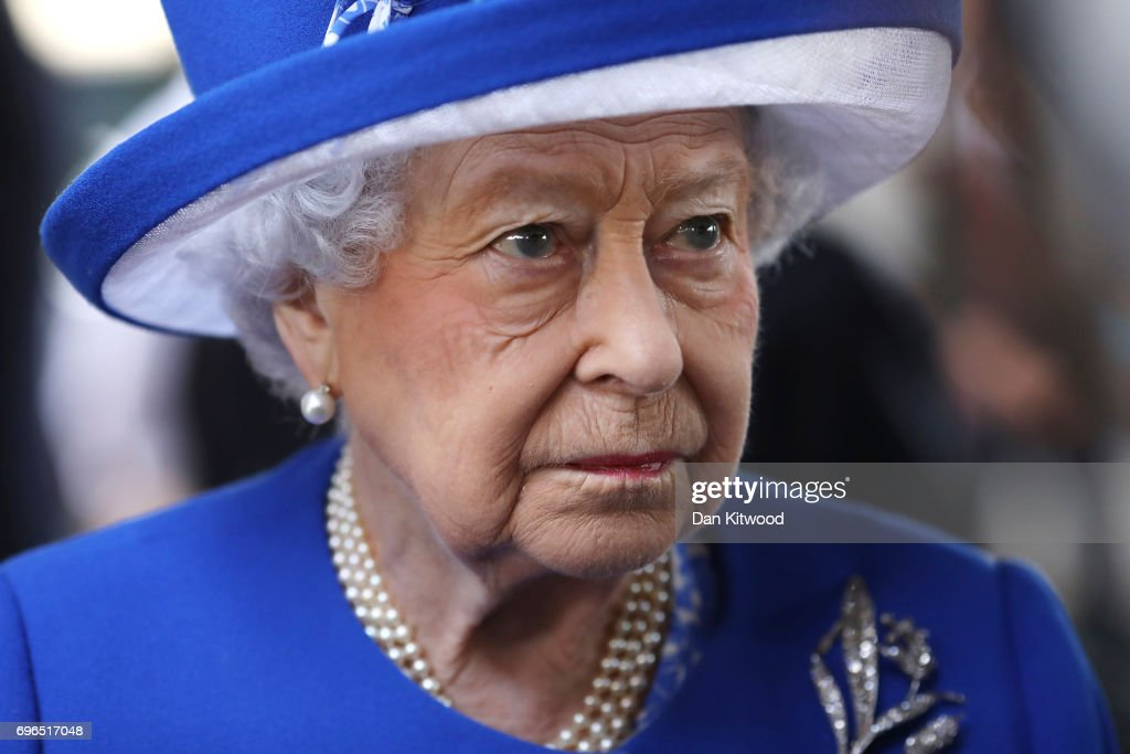 Queen Elizabeth II visits the scene of the Grenfell Tower fire on June 16, 2017 in London, England. 17 people have been confirmed dead and dozens still missing, after the 24 storey residential Grenfell Tower block in Latimer Road was engulfed in flames in the early hours of June 14. Emergency services will spend a third day searching through the building for bodies. Police have said that some victims may never be identified.