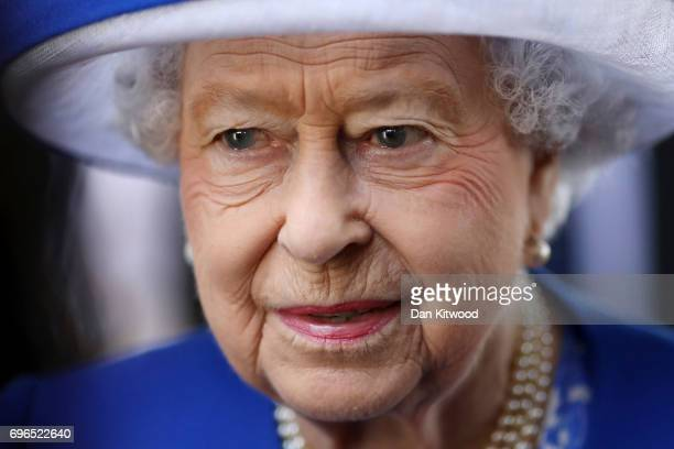 Queen Elizabeth II visits the scene of the Grenfell Tower fire on June 16 2017 in London England 17 people have been confirmed dead and dozens still...