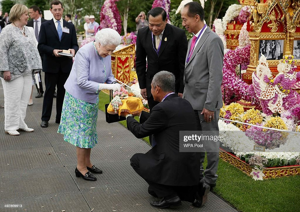 Queen Elizabeth II visits the Thai exhibit at the Chelsea Flower Show on press day on May 19, 2014 in London, England.
