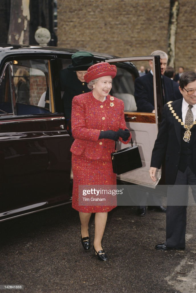 Queen Elizabeth II visits the United Westminster Almshouses on Rochester Row in London, 22nd February 1996. She is carrying a handbag by Launer.