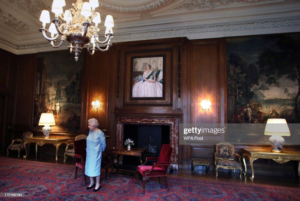Queen <a gi-track='captionPersonalityLinkClicked' href=/galleries/search?phrase=Elizabeth+II&family=editorial&specificpeople=67226 ng-click='$event.stopPropagation()'>Elizabeth II</a> waits for the arrival of Scottish First minister Alex Salmond for an audience at the Palace of Holyrood House on July 2, 2013 in Edinburgh, Scotland. The Queen has several engagements on her annual week in Scotland.