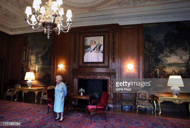 Queen Elizabeth II waits for the arrival of Scottish First minister Alex Salmond for an audience at the Palace of Holyrood House on July 2 2013 in...