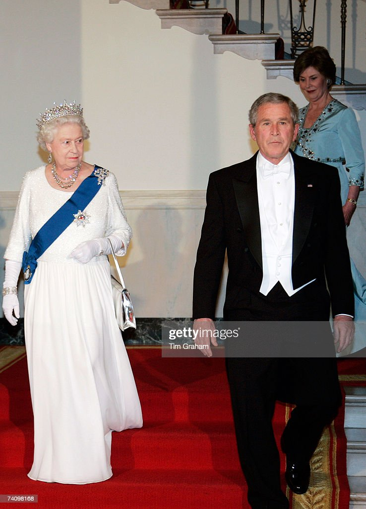 Queen Elizabeth II waks with President George W Bush and his wife Laura Bush down the White House stairs to attend a State Dinner on the fifth day of her USA tour on May 7, 2007 in Washington, DC.
