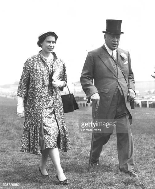 Queen Elizabeth II walking with Harry Primrose 6th Earl of Roseberry at the Epsom Derby England August 5th 1959
